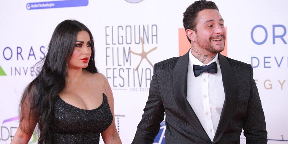 بالفيديو: في مهرجان القاهرة.. أحمد الفيشاوي يثير الجدل مجدداً بتقبيل زوجته