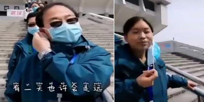 بالفيديو: أطباء صينيون يخلعون كماماتهم بعد الانتصار على ''كورونا''