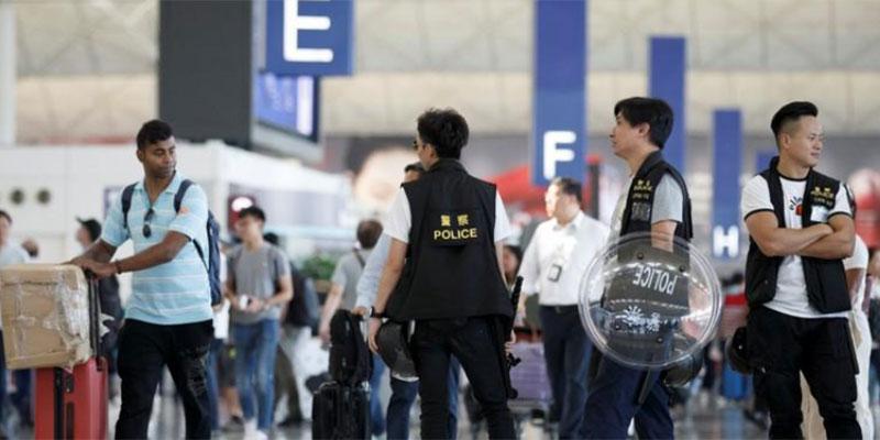 عشرات من محتجي هونج كونج يمثلون أمام محكمة بتهم شغب