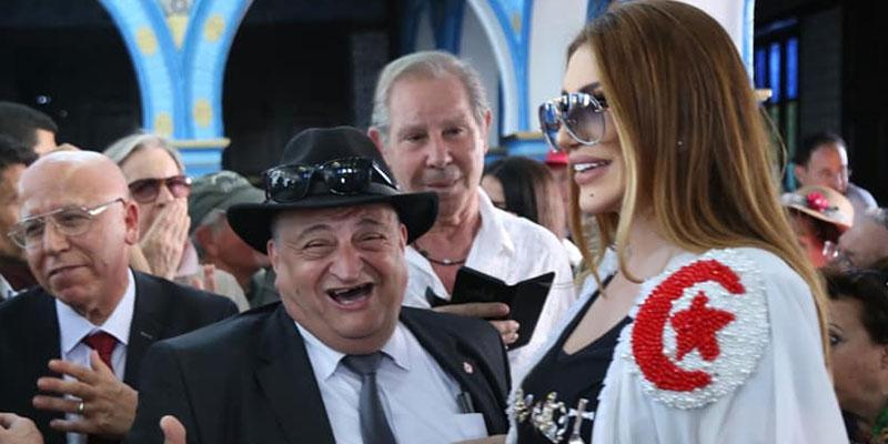 En photos : Amina Sta porte le drapeau tunisien à la Ghriba