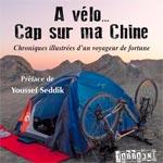 Seul avec son vélo et le drapeau de la Tunisie, il traverse l'Asie vers la Chine